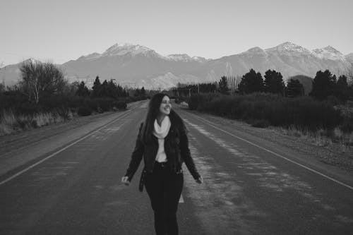 Woman in Black Jacket Standing on Road