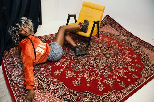 Woman Lying on Area Rug