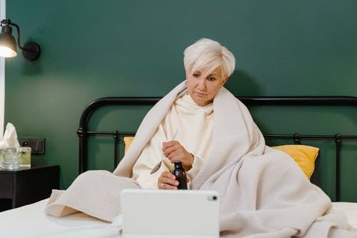 Woman in White Sweater with White Hair