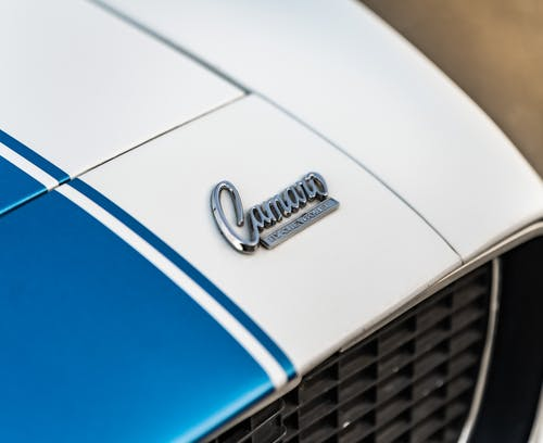 A Close-up Shot of a Car Badge on the Hood