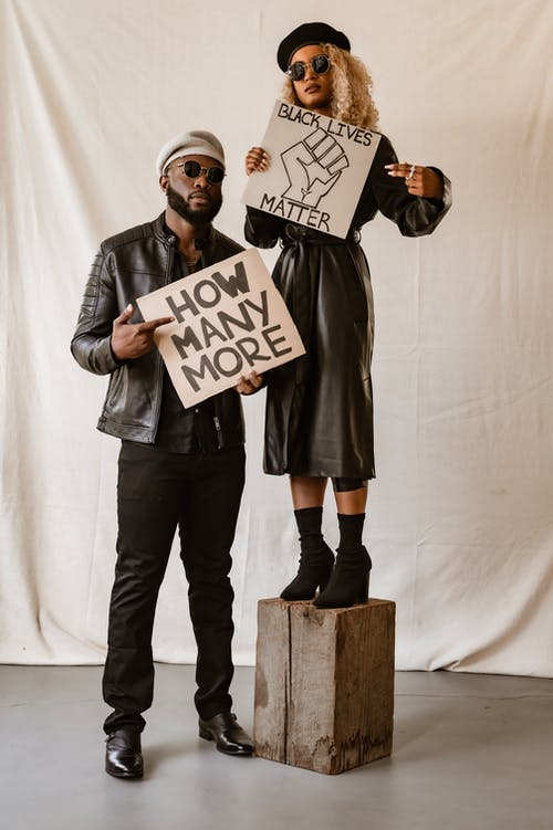 A Man and a Woman in a Nonviolent Protest Studio Shoot
