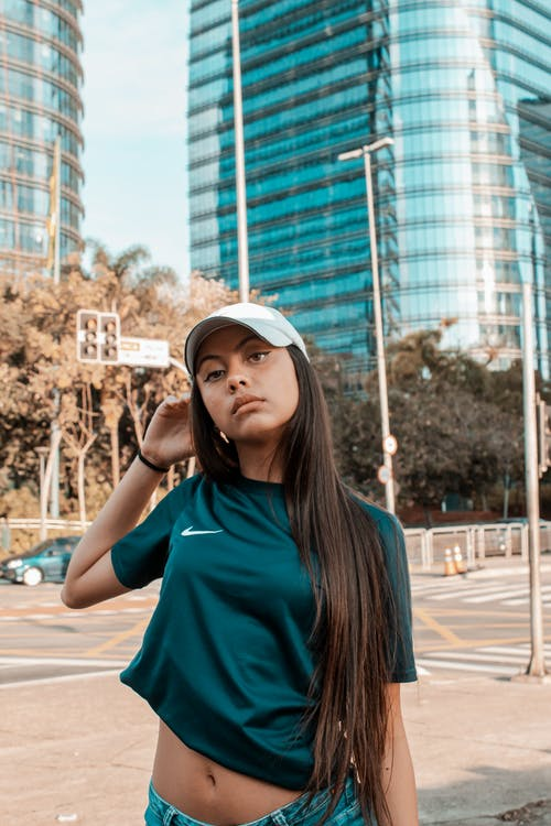 An Attractive Woman in Streetwear Looking at the Camera