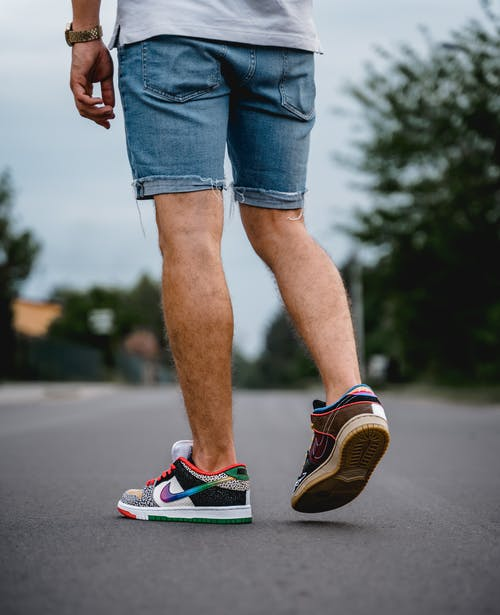 A Person Wearing a Pair of Sneakers