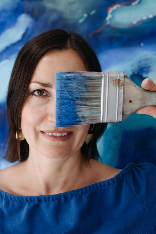\A Woman Holding a Paint Brush