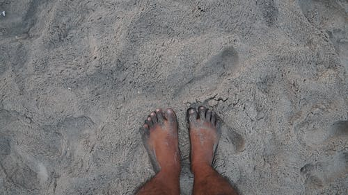 Free stock photo of leg with sand