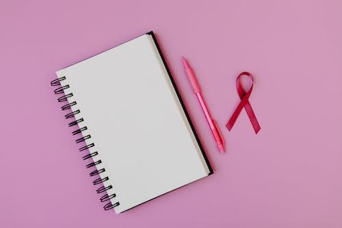 Red Handled Scissors Beside White Notebook