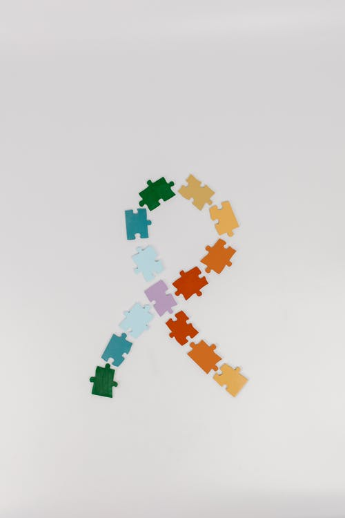 Green Orange and Yellow Puzzle Pieces