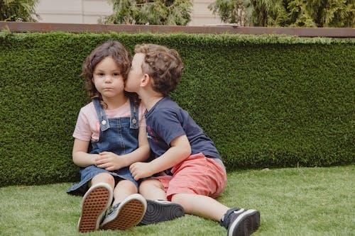Little Boy Kissing a Little Girl