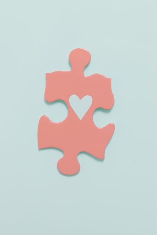 Pink Puzzle Piece on White Surface