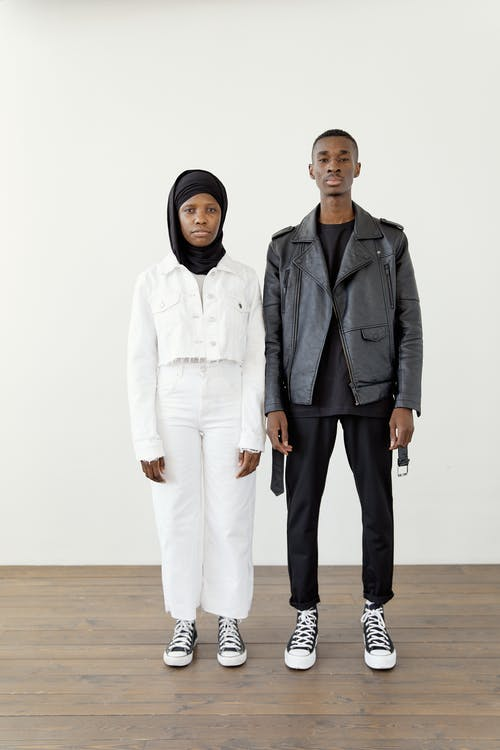 A Couple Standing on the Wooden Floor