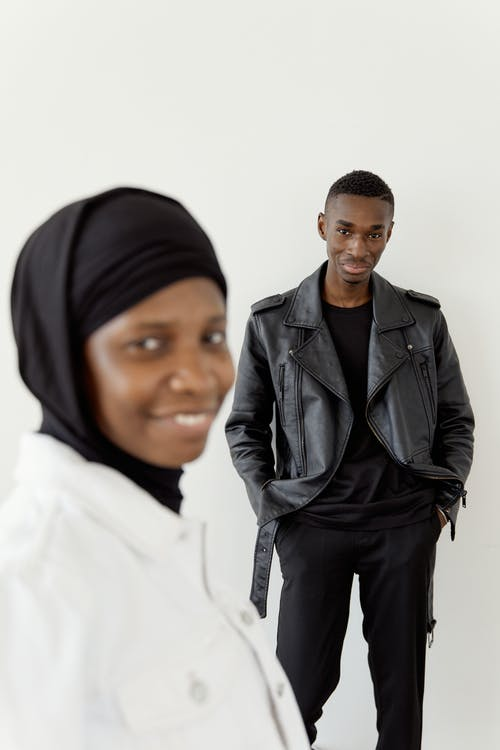 A Couple Standing Near White Background