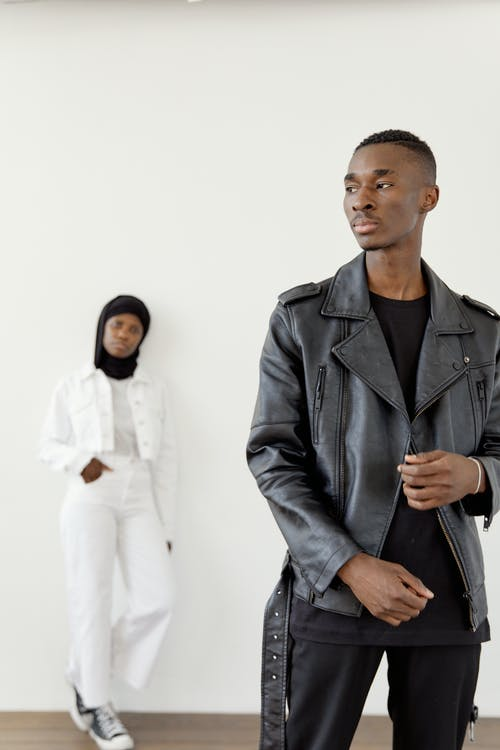 A Man in Black Clothes and a Woman in White Clothes