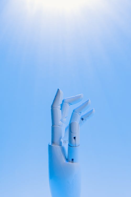 Robot's Hand on Blue Background