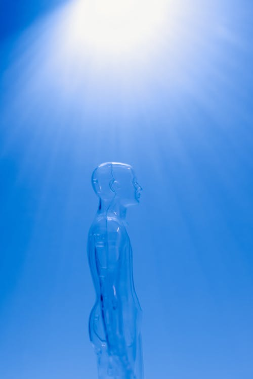 Clear Mannequin on Blue Background