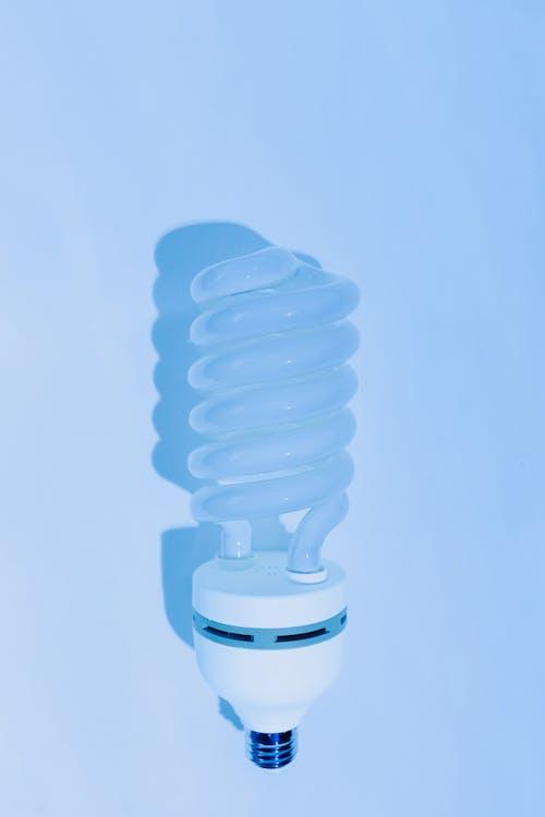 Lightbulb on a Blue Surface