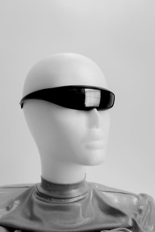 Grayscale Photo of a Mannequin Wearing Sunglasses
