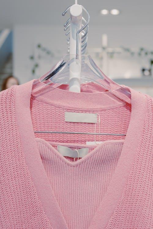 Pink V Neck Shirt on White Plastic Clothes Hanger