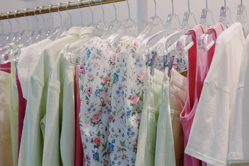 White Blue and Yellow Floral Dress Hanging on Clothing Rack