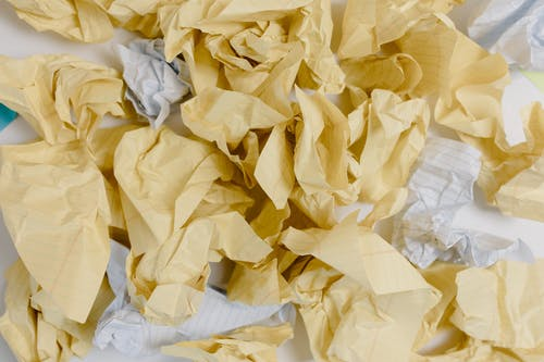 Crumpled White and Yellow Paper