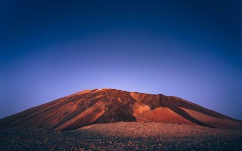 Brown Mountain Under Blue Sky
