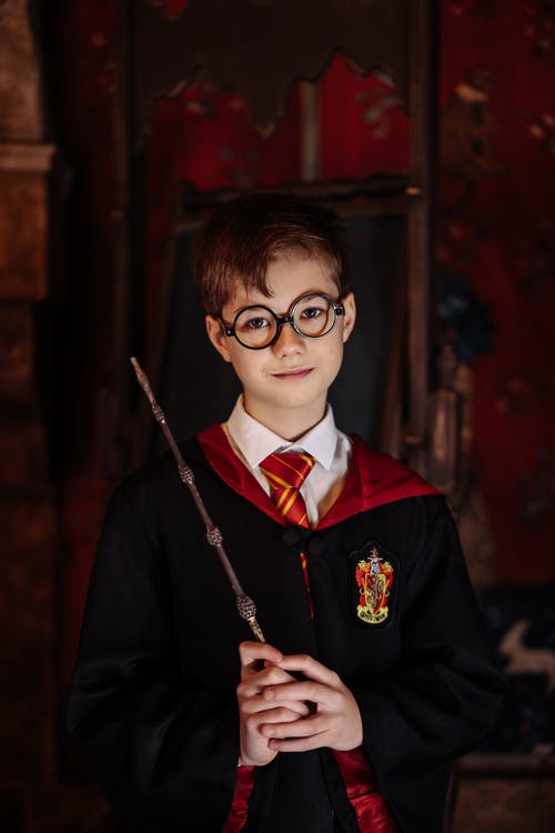 Boy in Black Framed Eyeglasses Holding a Magic Wand