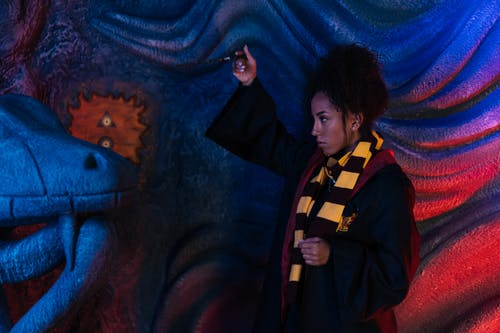 Curly Haired Woman Holding a Wand