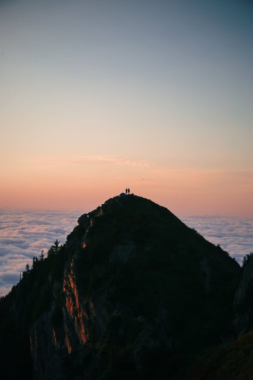 Silhouette of People on top of the Mountain