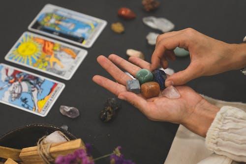 Person Holding Gemstones