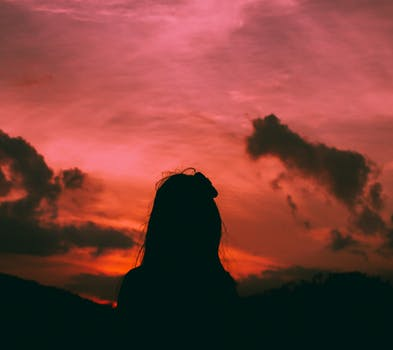 Silhouette of a Woman During Dawn