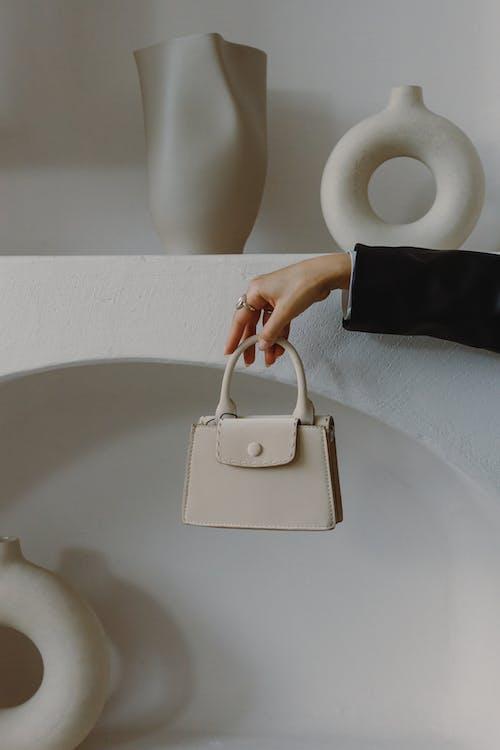Person Holding Beige Leather Handbag
