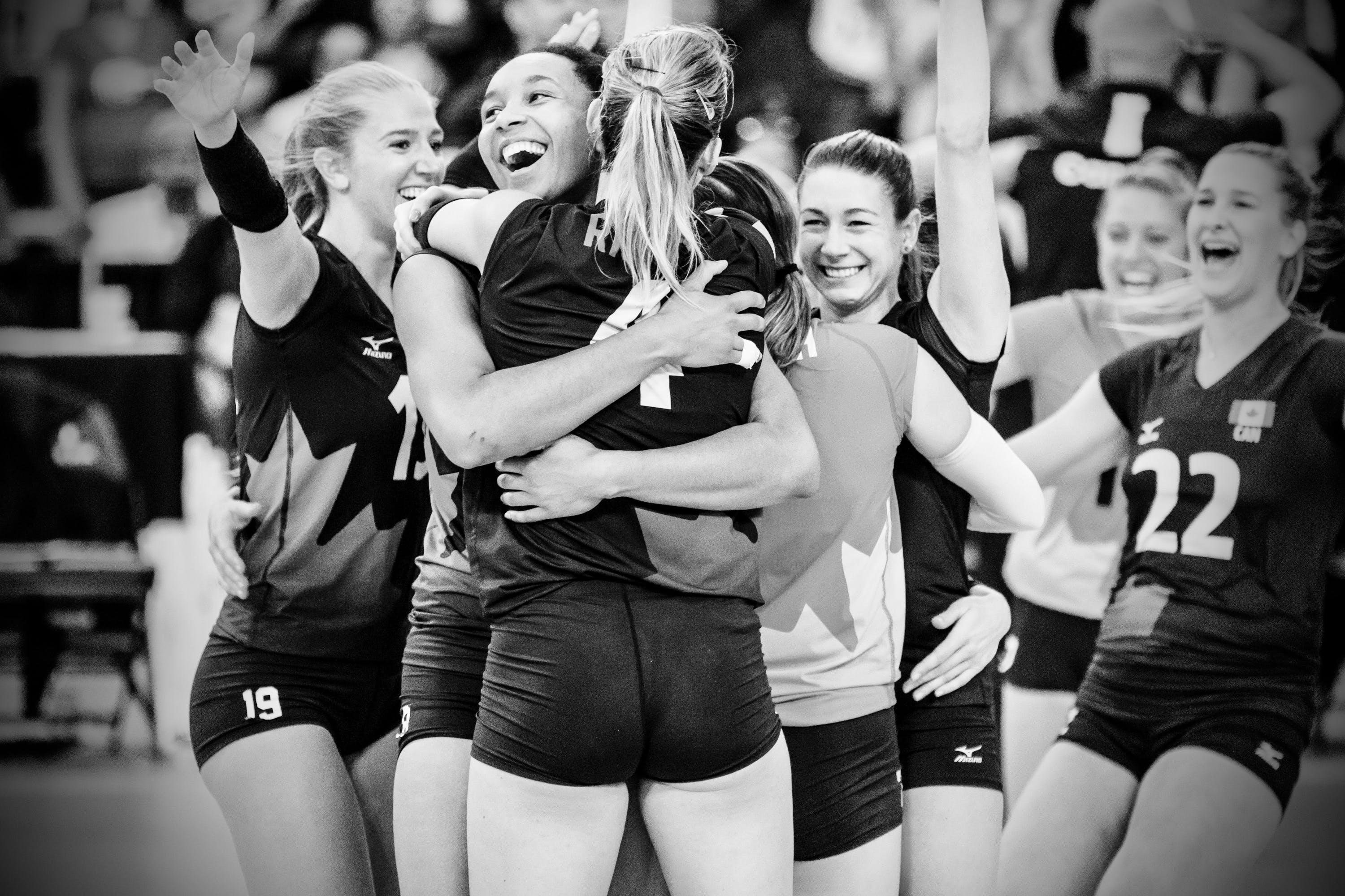 Volleyball Player Hugging Each Other