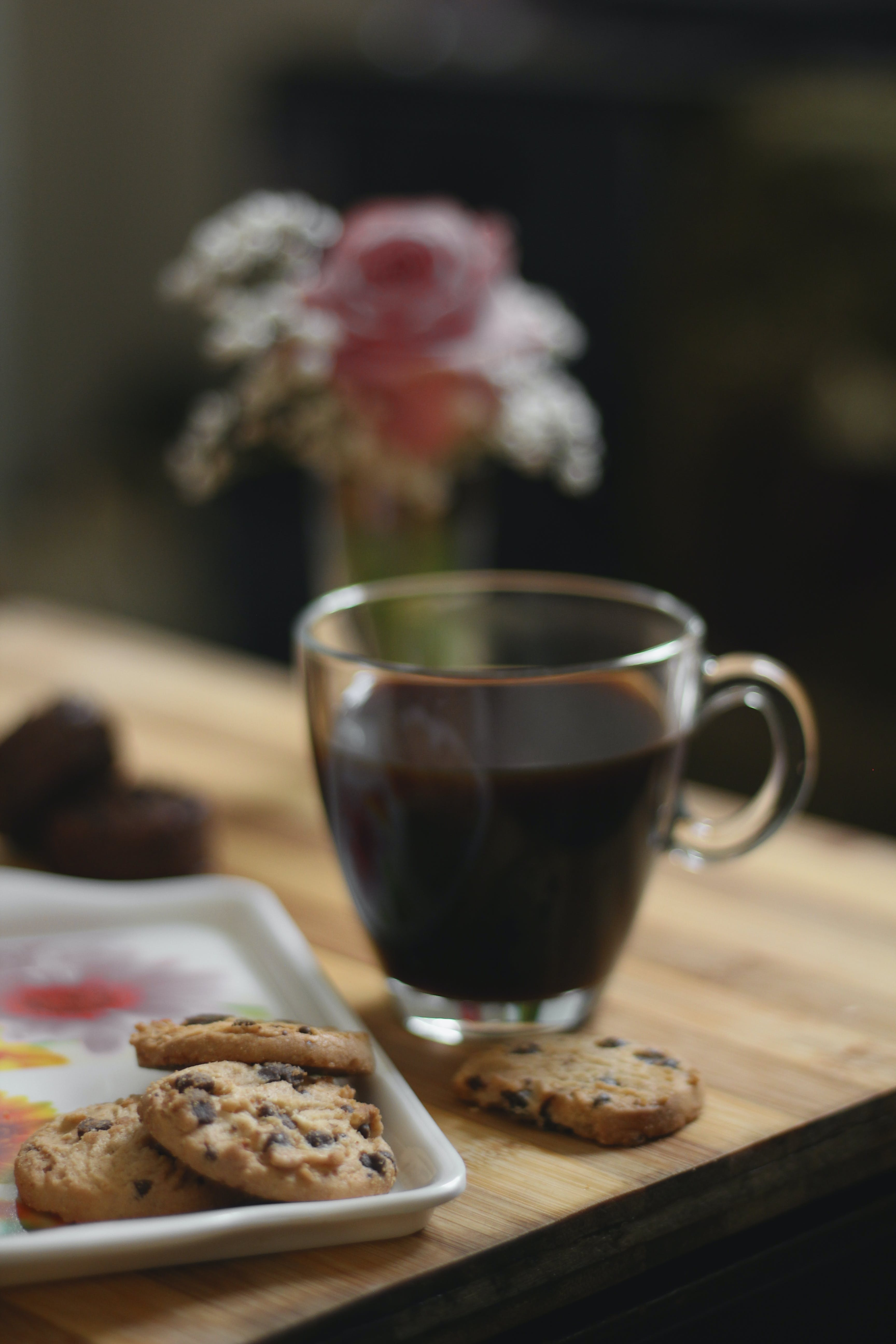 Glass Teacup Beside a Cookies on Tray Placed on Table