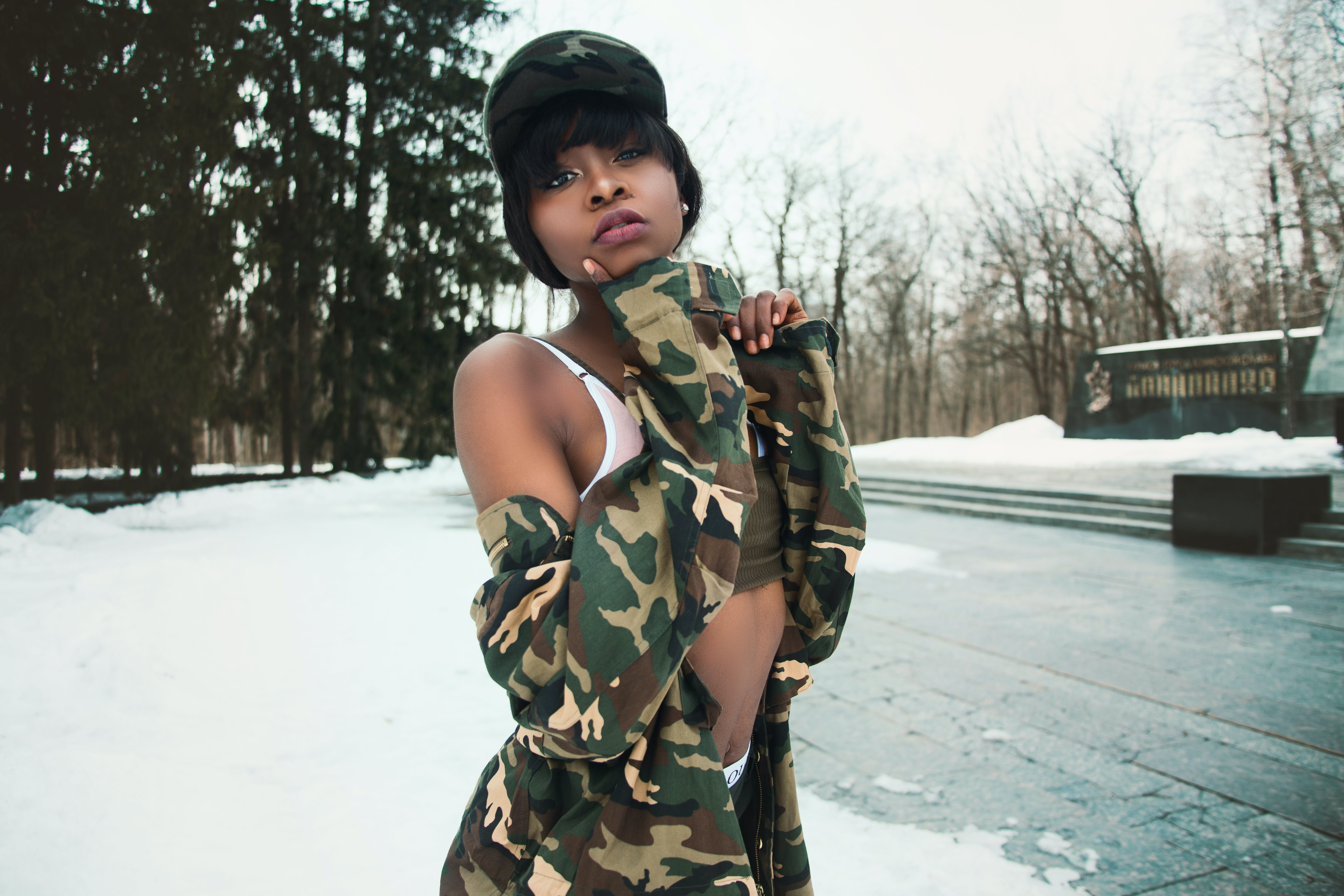 Woman Wearing Camouflage Shirt Covered by Snow