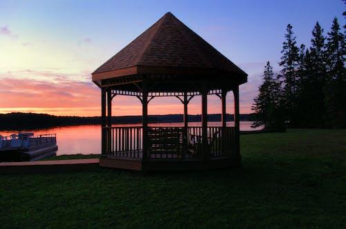 Photos gratuites de arbres, belvédère, ciel, coucher de soleil