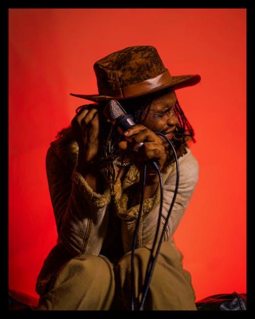Man in Brown Cowboy Hat and Brown Jacket