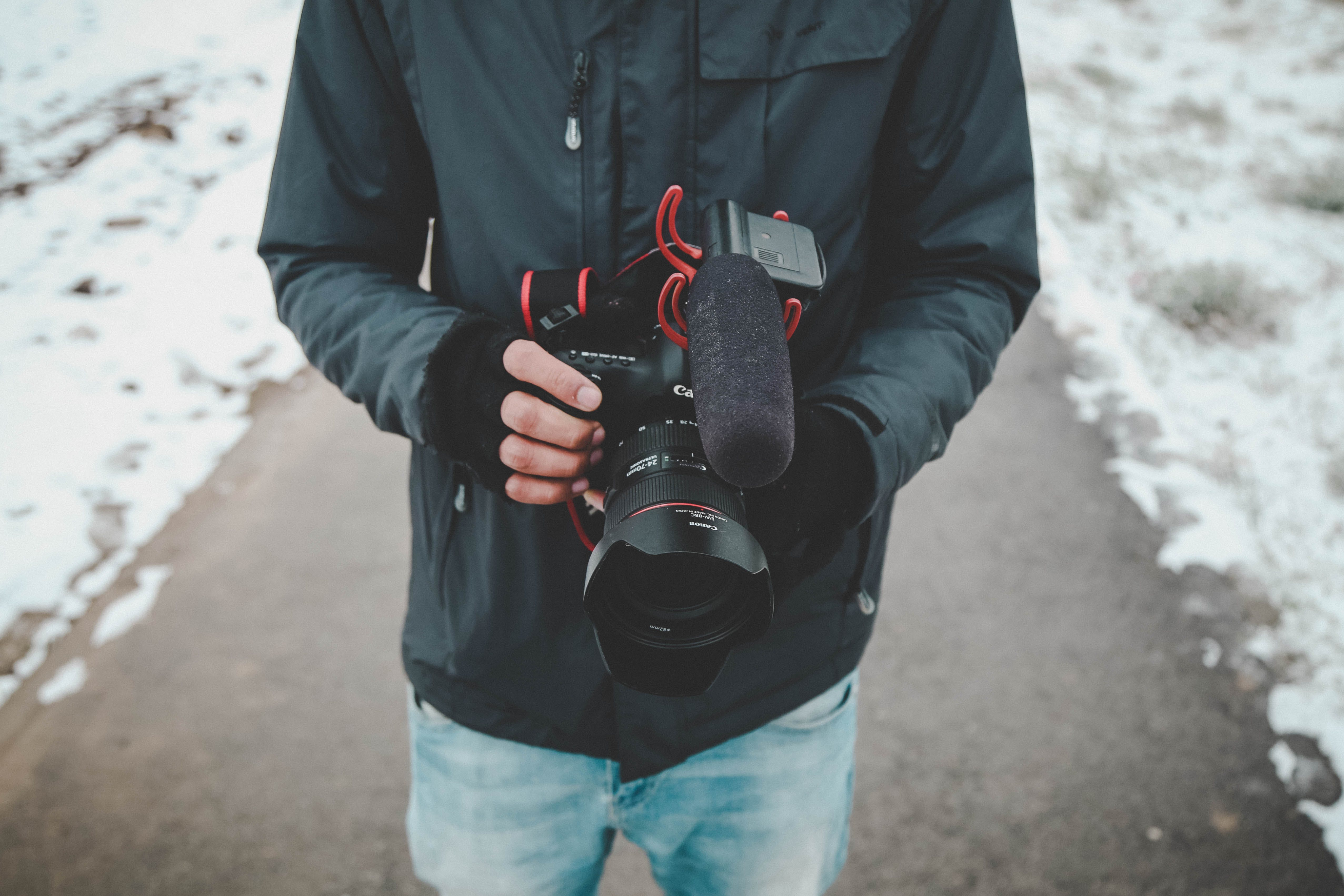 Man Holding Dslr Camera