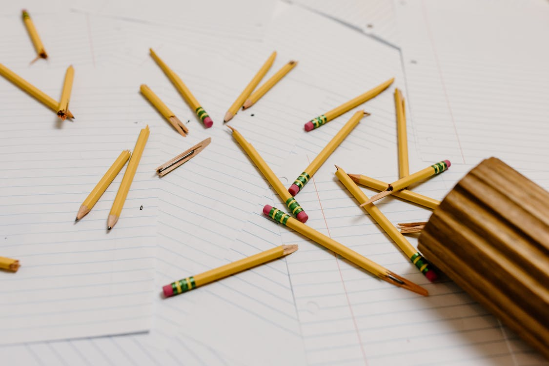 Brown Wooden Pencils on White Paper