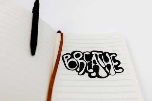 Black Pen on White Ruled Paper