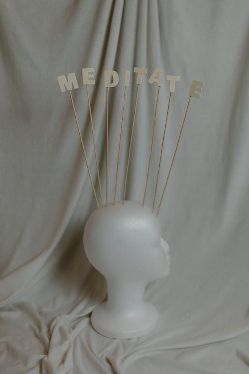 White Ceramic Figurine on White Textile