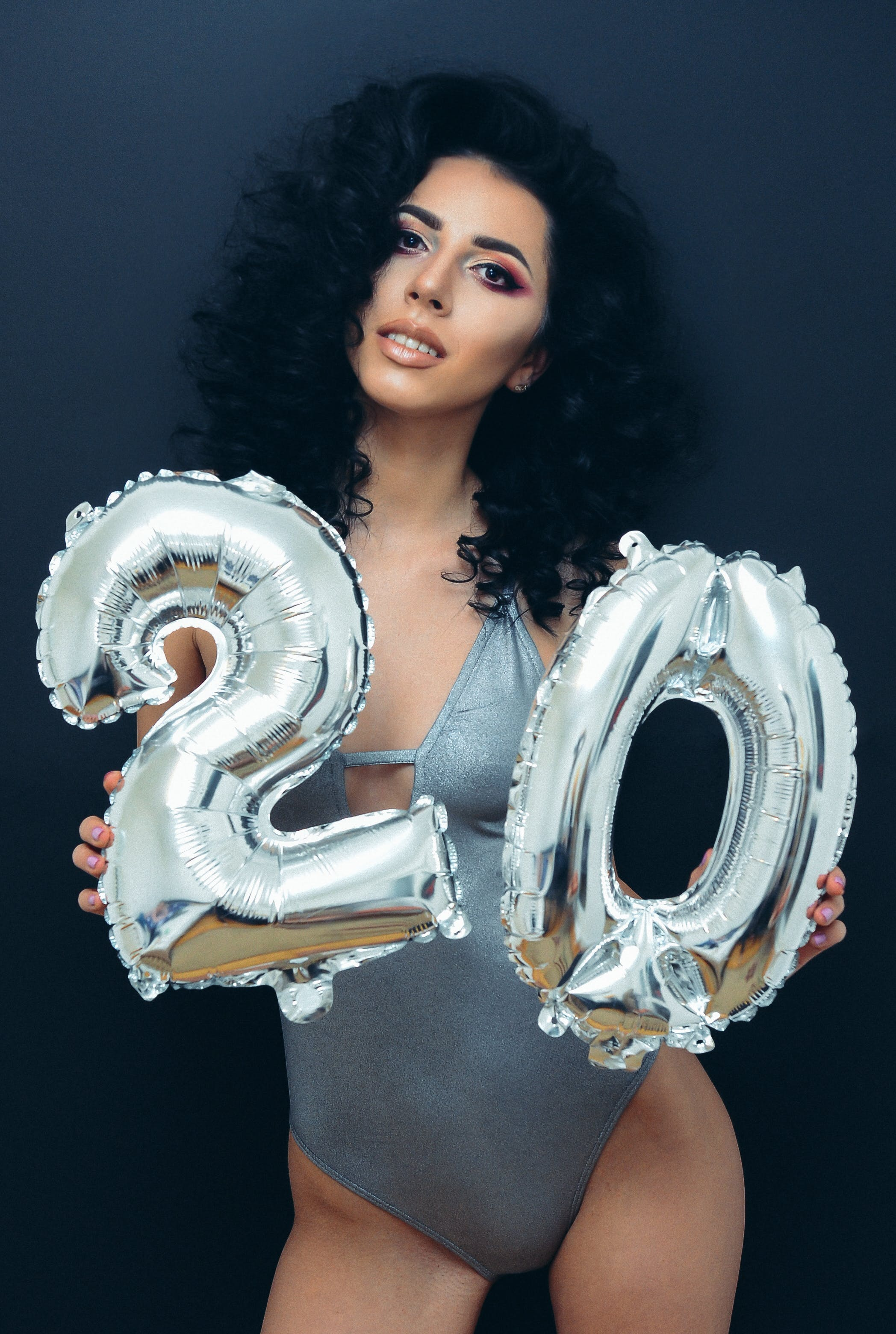 Woman Wearing Grey Swimsuit Holding Grey Balloons