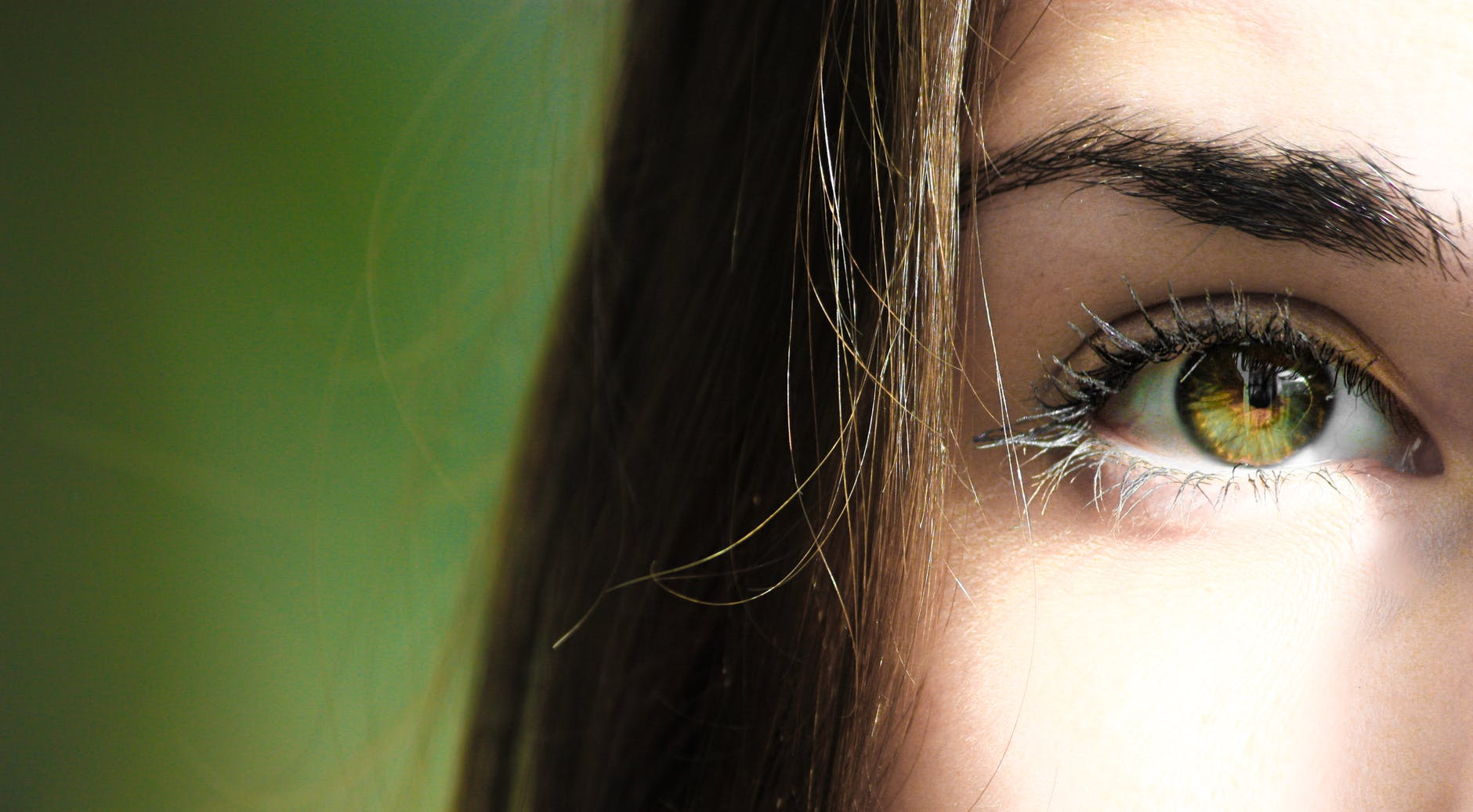 A close up shot of a woman with green eyes.