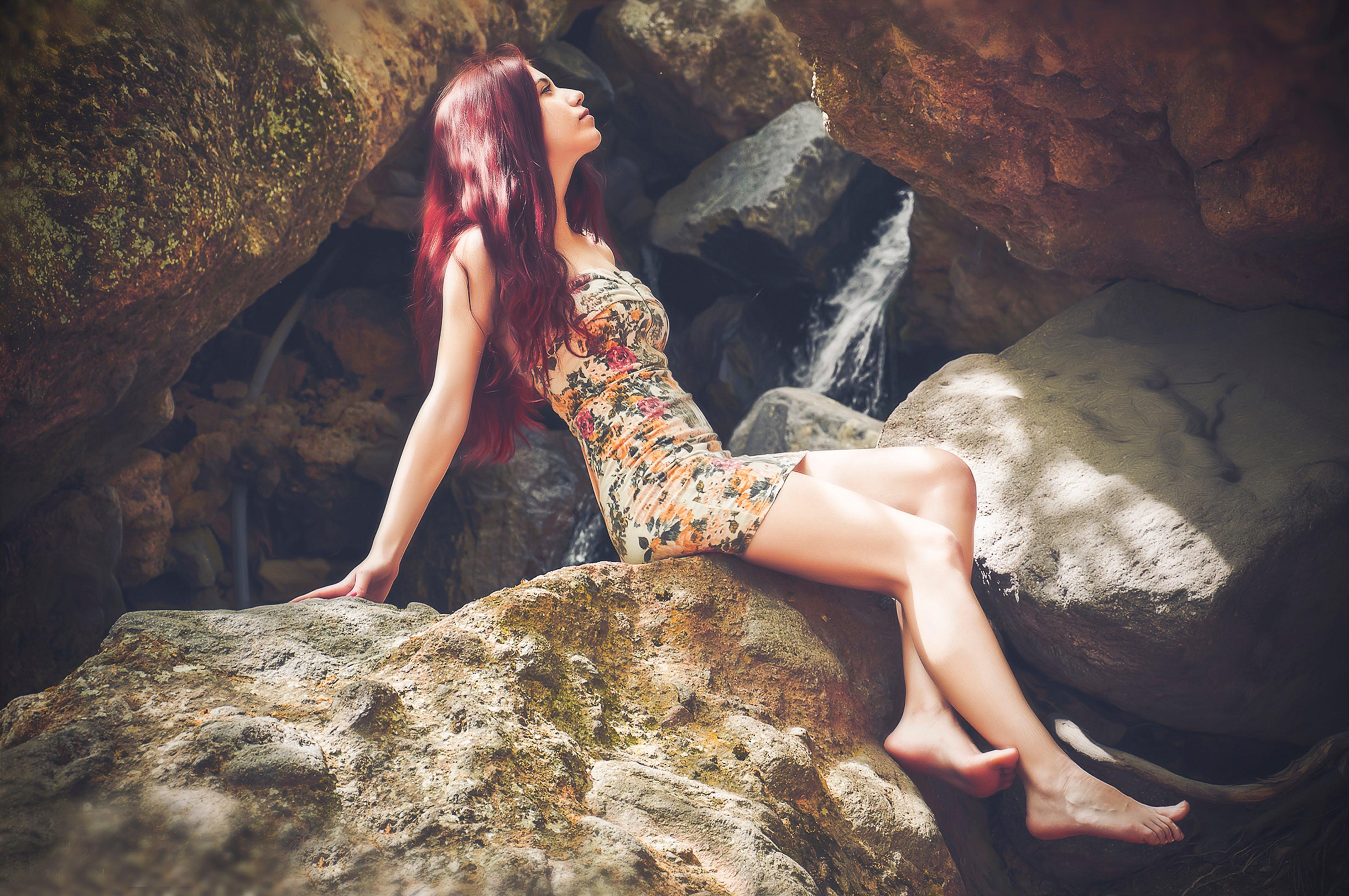 Woman in Bodycon Mini Dress Sitting on Boulder