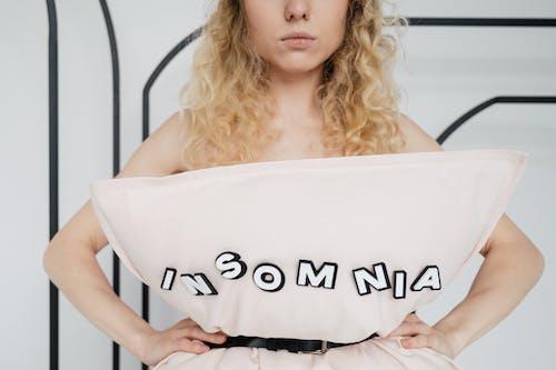 Woman Wearing a Pillow Using a Belt