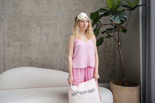 Woman in Pink Sleeveless Sleepwear