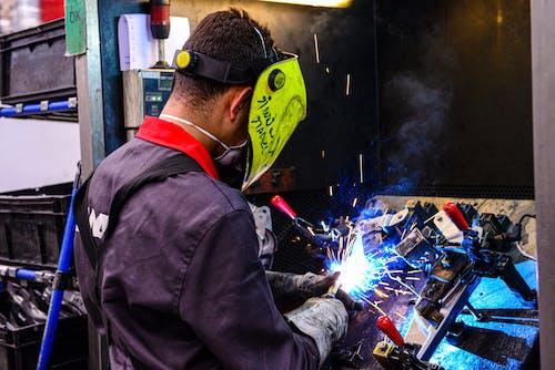 Man Using a Welding Machine