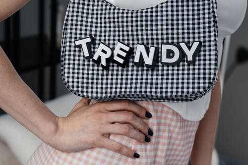 Woman Carrying a Black and White Plaid Bag