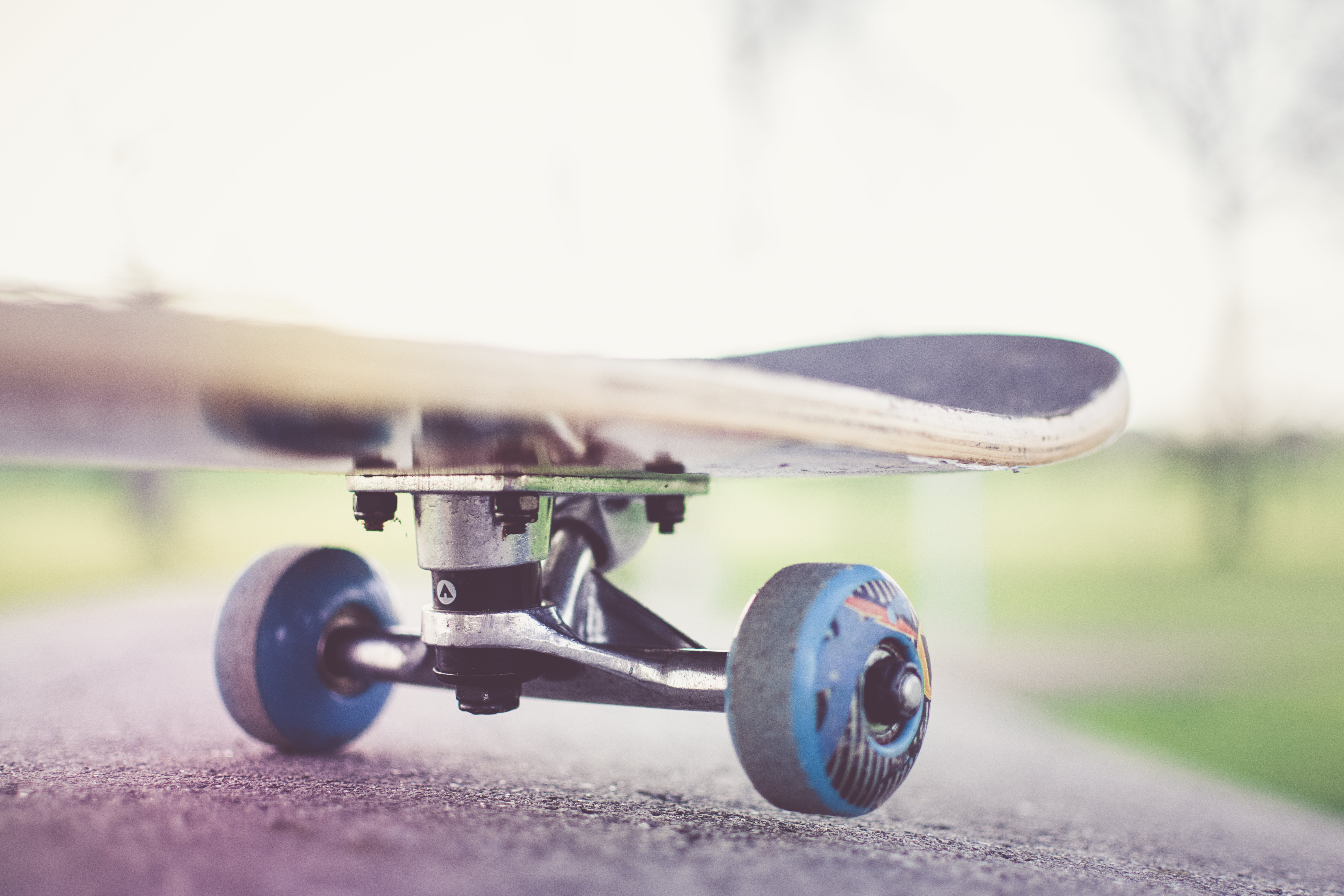 Tilt Shift Lens Photography of Black Skateboard