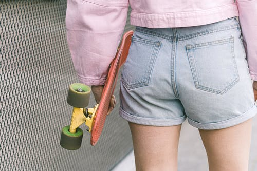 Person in Blue Denim Shorts