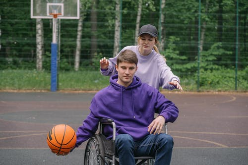 Boy in Purple Hoodie Sitting on Black and Gray Stroller