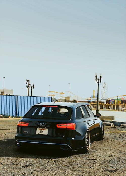 A Hatchback Car Parked in a Parking Lot
